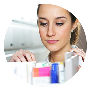 Woman looking in pill drawer